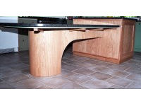 Dining island in oak and black granite 1